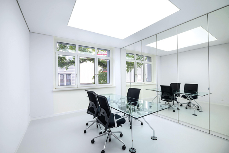 Illuminated stretch ceiling with LEDs, inside an office